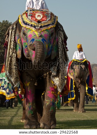 JAIPUR, INDIA - MARCH 10: Colorful painted elephants and performers parade for the annual elephant festival on March 10, 2009 in Jaipur, India