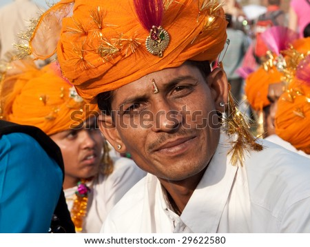 JAIPUR, INDIA - MARCH 10: Musician in traditional dress for the annual elephant festival on March 10, 2009 in Jaipur, India - stock photo