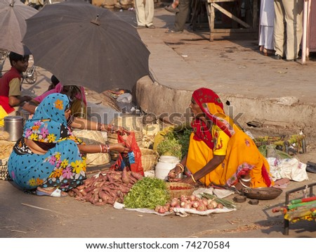 JAIPUR, INDIA - NOVEMBER 12: An unidentified woman sells vegetables by the road on November 12, 2007 in Jaipur, Rajasthan, India. In India poor women often sell vegetables to earn a small cash income.