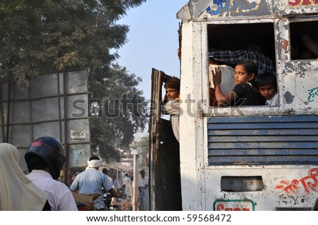 JAIPUR, INDIA - NOVEMBER 1: Group of people travel by crowdy bus on November 1, 2009 in Jaipur. Unsatisfactory quantity of public transportation limits indian people in everyday traveling.
