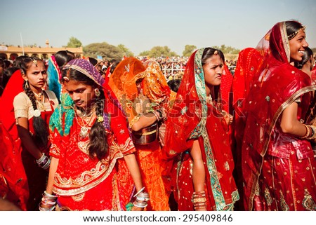 JAISALMER, INDIA - MAR 1: Many faces of indian women in the colorful crowd of the rural Desert Festival on March 1, 2015 in Rajasthan. Every winter Jaisalmer takes the Desert Festival