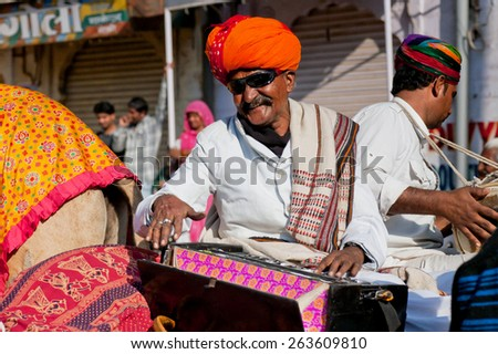 JAISALMER, INDIA - MAR 1: Music band of elderly Rajasthan musicians play songs for visitors of the Desert Festival on March 1, 2015 in India. Every winter Jaisalmer takes the famous Desert Festival