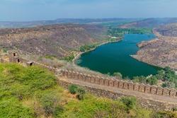 Jait Sagar lake and the walls of Taragarh Fort in Bundi, Rajasthan state, India