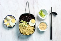 Jajangmyeon or JJajangmyeon  is Korean Noodle with Black Sauce and Boiled Egg