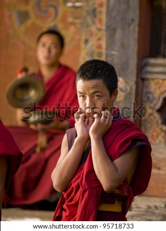 JAKAR, BHUTAN - OCTOBER 23, 2010: Monks rehearsing for the Jakar tsechu which is held the next day on Oct. 23, 2010 in Jakar. Tsechu are annual religious Bhutanese festivals usually around October