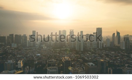 JAKARTA - Indonesia. April 04, 2018: Silhouette of modern downtown skyscraper buildings at sunset in Jakarta, Indonesia #1069503302