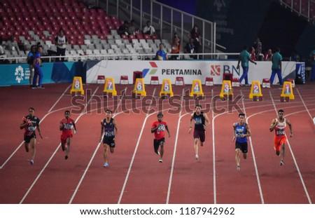 Jakarta, Indonesia - August 18, 2018 : Runner's Men's 100m event at the GBK Main Stadium during 2018 Asian Games Jakarta. #1187942962