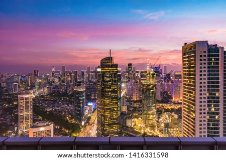Jakarta, Indonesia - 20 Dec 2018: Beautiful Jakarta cityscape at sunset from The Cloud Lounge, The Plaza Office Tower, in Central Jakarta. Jakarta Central Business District. #1416331598
