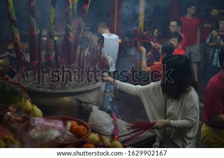 Jakarta, Indonesia - February 19, 2015 : women who worship during the Chinese New Year
