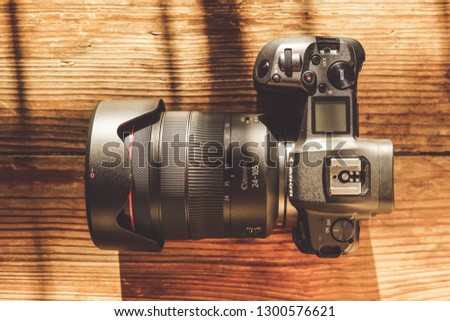Jakarta, Indonesia - January 31, 2019: The Canon EOS R full frame mirrorless camera with RF 24-105mm f/4L USM lens. #1300576621