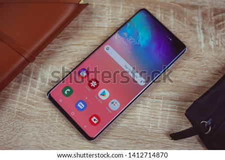 Jakarta, Indonesia - June 1, 2019: The Samsung Galaxy S10+ flagship Android smartphone has a 6.4 inch Dynamic AMOLED screen and in-screen fingerprint reader.  #1412714870
