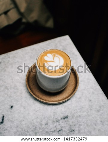 JAKARTA, INDONESIA - May 16, 2019: A Cup of Coffee Latte in Jakarta Indonesia #1417332479