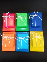Jakarta-Indonesia, 28 October 2020: Colorfull gift or present on a black surface is giving happy and cheerfull mood. Gift is first and usually presented on occasions such as birthday and holiday.