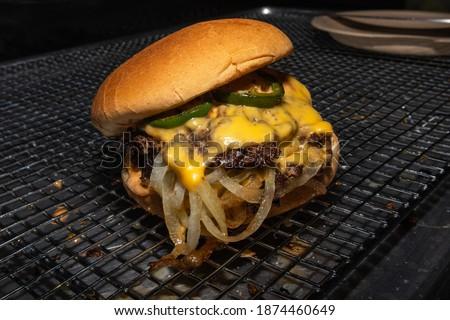 Photo of  Jalapeño, cheese, and onion smash burger