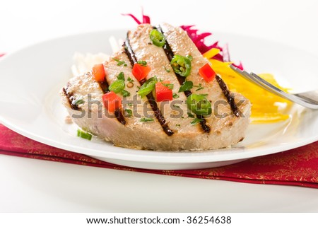 Jalapeno marinated grilled tuna steak with beet and jicama s..