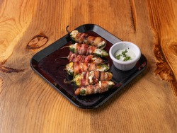 Jalapeno poppers. Spicy peppers stuffed with cream cheese and wrapped in bacon. Perfect finger food appetizer.