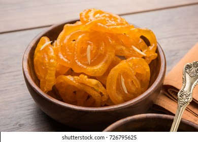 Stock photo of Jalebi or Jilbi or imarati, indian sweet food fried in pure ghee, selective focus.