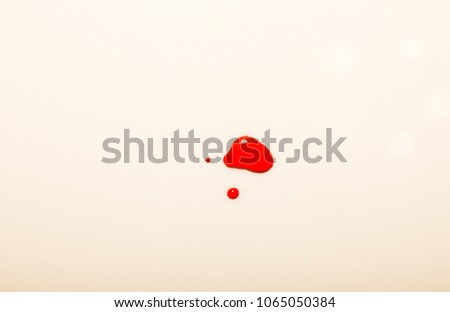 Jam (black currants) splats isolated on white background. Pink background. Professional photo session #1065050384