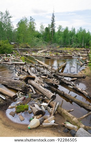 Jam from garbage and old trees on river in Western Siberia. The irresponsible relation to the nature