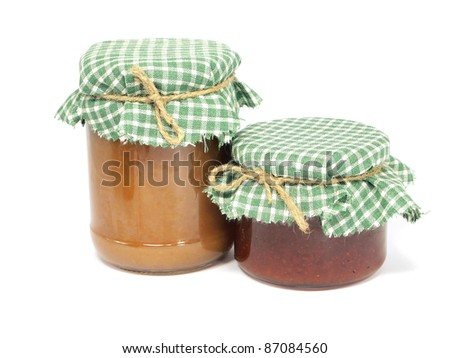 jam in glass jar on a white background