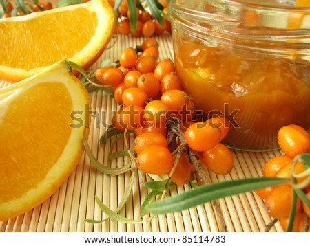 Jam with fruits of sea buckthorn and oranges