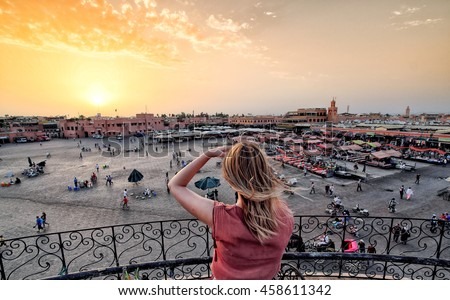Jamaa el-Fna market Marrakech at sunset. Tourist watching the shops in the old medina.   #458611342