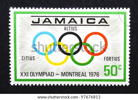 """JAMAICA - CIRCA 1976: a postage stamp printed in Jamaica showing an image of the olympic rings with the latin words """"altius, citius, fortius"""", circa 1976."""