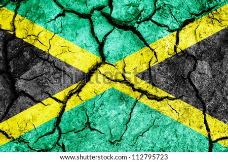 Jamaica flag on cracked earth background - stock photo