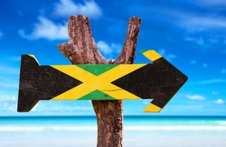 Jamaica Flag sign with beach background