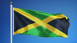 Jamaica flag waving against clean blue sky, close up, isolated with clipping path mask alpha channel transparency