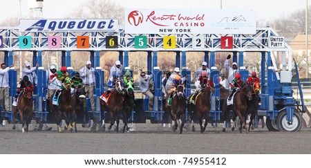 JAMAICA, NY - APR 9: The field breaks from the gate for the $1 Million Dollar Wood Memorial at Aqueduct Race Track on Apr 9, 2011 in Jamaica, NY. Eventual winner is No. 2, Toby's Corner. - stock photo