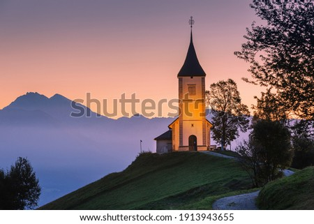 Jamnik, Slovenia - view the church of St. Primoz in Slovenia near Jamnik, Julian Alps at background. Zdjęcia stock ©