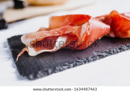 Jamon serrano. Traditional Spanish ham, Slicing of dry-cured ham in Spain Stock photo ©