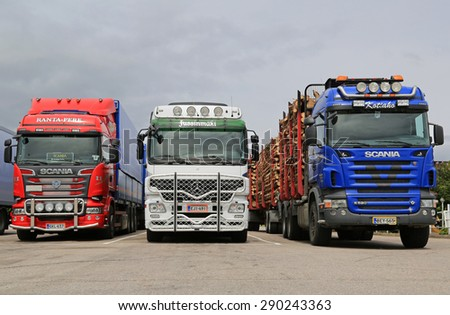 JAMSA, FINLAND -  JUNE 18, 2015: Scania and Mercedes-Benz Actros trucks at a truck stop. Road transport goes on throughout the Finnish celebration of Midsummer.