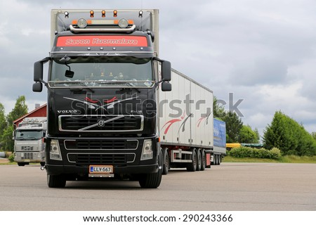 JAMSA, FINLAND - JUNE 18, 2015: Volvo FH16 semi truck leaves a truck stop. Volvo Trucks certify all engines for the diesel HVO.