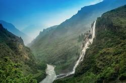 Jang Falls also known as Nuranang Falls or Bong Bong Falls, some 100 metres high waterfall it falls into Nuranang River and engulfed by mountains, Tawang district, Arunachal Pradesh, India.
