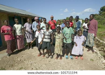 JANUARY 2007 - A group of HIV/AIDS infected children sing song about AIDS at the Pepo La Tumaini Jangwani, HIV/AIDS Community Rehabilitation Program, Orphanage & Clinic.  Nairobi, Kenya, Africa - stock photo