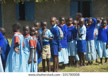JANUARY 2005 - Children in blue lineup at school near Tsavo National Park, Kenya, Africa