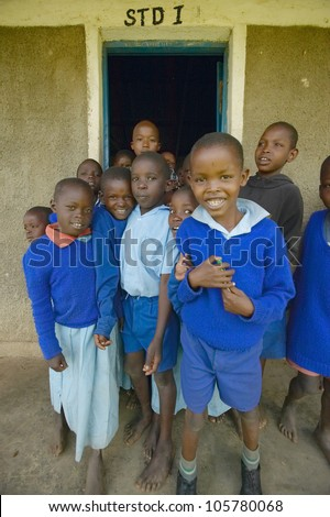 JANUARY 2005 - Children in blue uniforms at school near Tsavo National Park, Kenya, Africa