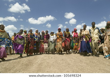 JANUARY 2007 - Grandmothers, who are the caretakers of their children and grandchildren who are infected with HIV/AIDS, dance at Pepo La Tumaini Jangwani, Nairobi, Kenya, Africa.