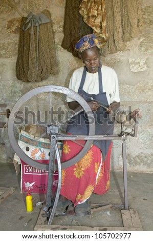 JANUARY 2007 - Masai woman weaves rug as part of a community based business at the Lewa Foundation in North Kenya, Africa.