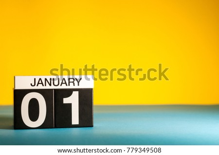 January 1st. Day 1 of january month, calendar on yellow background. Winter time. Empty space for text #779349508