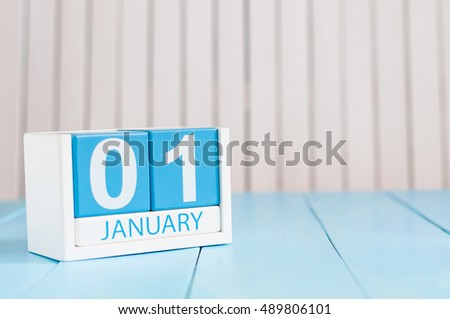 January 1st. Day 1 of month, calendar on wooden background. Winter time, New year concept. Empty space for text #489806101