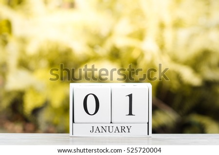 January 1st.Happy new year.Cube calendar on wooden table with Bokeh background. #525720004