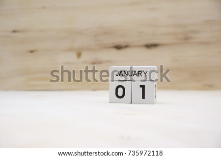 January 1st,January 1 white wooden calendar cube on wood background #735972118