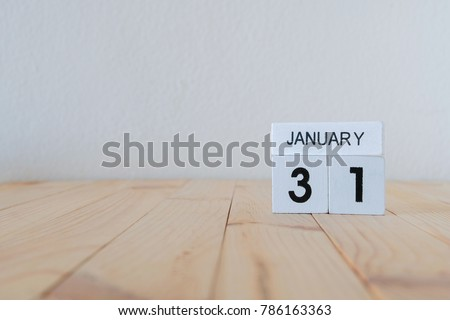 january 31st,January 31 white wooden calendar cube on wood background #786163363
