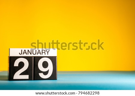 January 29th. Day 29 of january month, calendar on yellow background. Winter time. Empty space for text #794682298