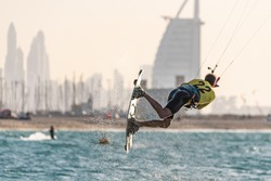 January 8th 2021, Dubai UAE,  a kitesurfer while participating in the free style competition of Kite surf open in Kite Beach with Burj Al Arab as a backdrop, Dubai
