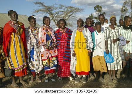JANUARY 2005 - Village people singing at sunset in village of Nairobi National Park, Nairobi, Kenya, Africa