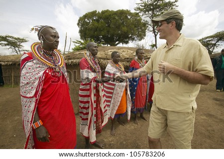 JANUARY 2005 - Wayne Pacelle CEO of Humane Society of United States meeting Masai females in robes in village near Tsavo National Park, Kenya, Africa